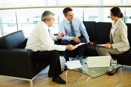 Portrait of busy people discussing new working plan at meeting photo