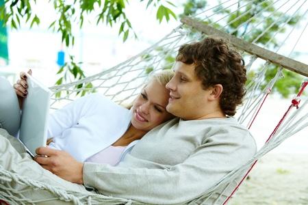 laptop outside: Happy dates with laptop lying in hammock