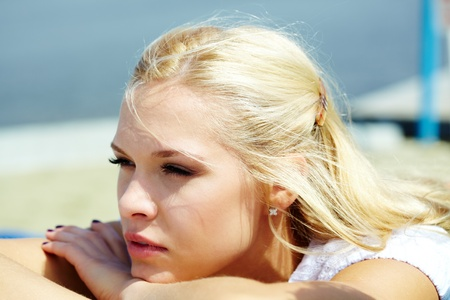 Photo of serene blond woman spending time outdoors photo