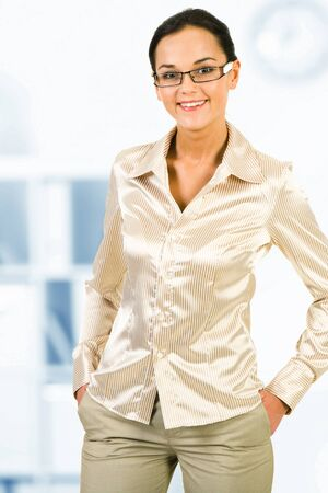 Portrait of pretty white collar worker looking at camera in office Stock Photo - 10575191