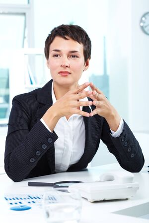 Photo of smart businesswoman sitting in office photo