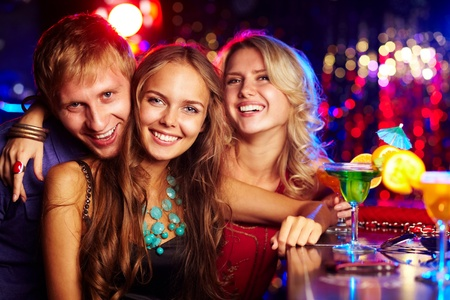 company party: Image of happy friends looking at camera at party