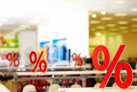 bargain: Sign of discount in clothing department during sale Stock Photo