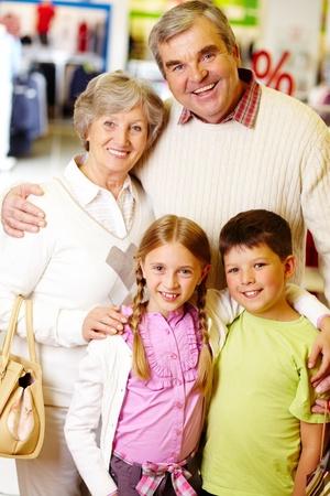 Portrait of happy grandparents and grandchildren during shopping photo