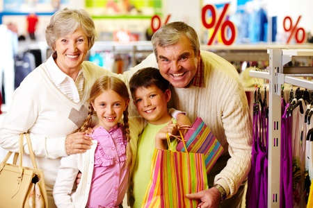 mature old generation: Portrait of happy grandparents and grandchildren during shopping Stock Photo