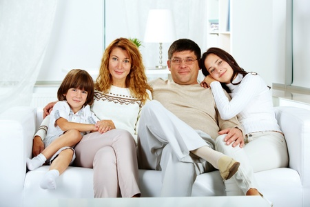 Photo of happy family looking at camera at home photo