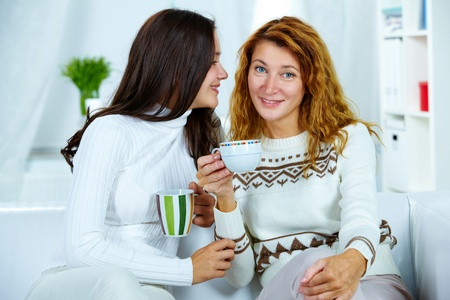 feminine beauty: Photo of pretty woman looking at camera with her teenage daughter near by Stock Photo