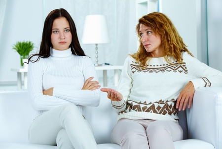 argument: Photo of pretty woman looking at her teenage daughter during argument Stock Photo