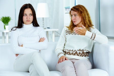 people arguing: Photo of pretty woman looking at her stubborn daughter during argument