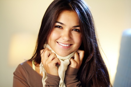 Image of young woman with dark long hair smiling at camera  photo