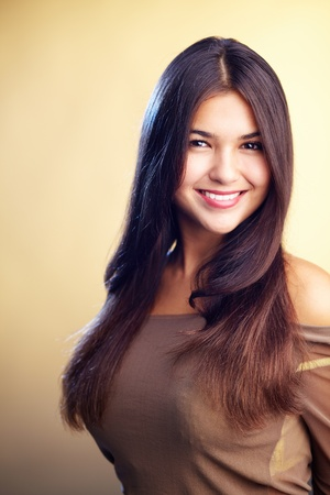 Image of perfect woman looking at camera with smile photo