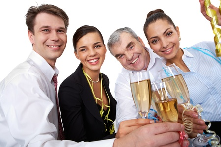 Photo of businesspeople cheering up their flutes filled with sparkling champagne photo