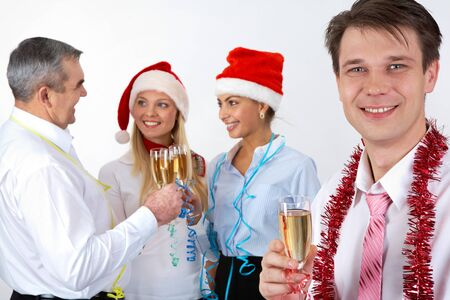 festive occasions: Portrait of happy businessman with champagne on background of partners