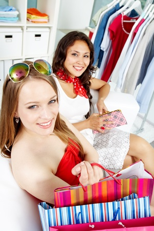 Portrait of happy shoppers with bags looking at camera after shopping Stock Photo - 10664491