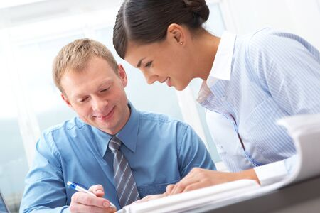 Manager showing plans to his female subordinate Stock Photo - 10699731