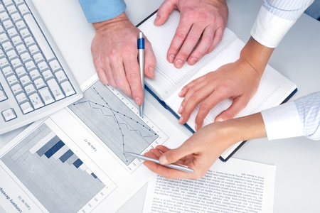 Place of work with papers and documents and hands of people working with them Stock Photo - 10699812