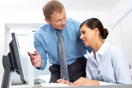Manager giving opinion to his secretary  Stock Photo - 10699744
