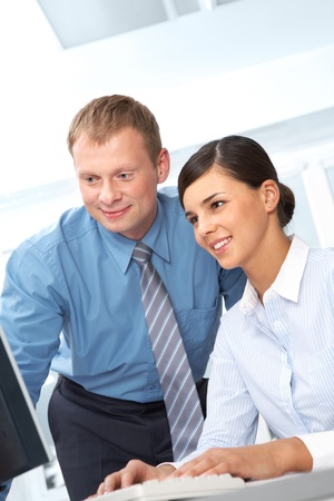 Leader and his secretary looking together at computer monitor Stock Photo - 10695240