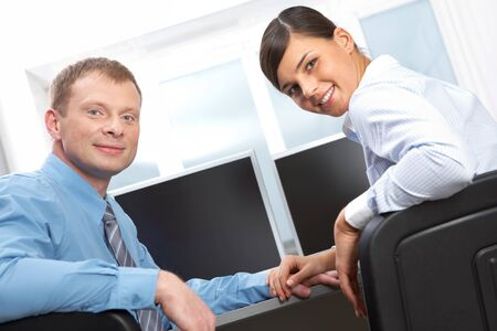 Two business colleagues looking at camera and smiling Stock Photo - 10699728