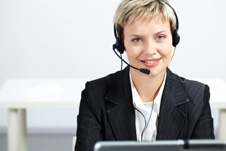 Portrait of pretty blond operator looking at camera and smiling Stock Photo - 10699955