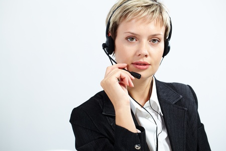 Portrait of customer service operator with headset looking at camera Stock Photo - 10699991