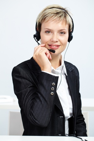 customer service representative: Portrait of customer service representative answering a call Stock Photo