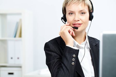 answering call: Portrait of attractive receptionist with headset
