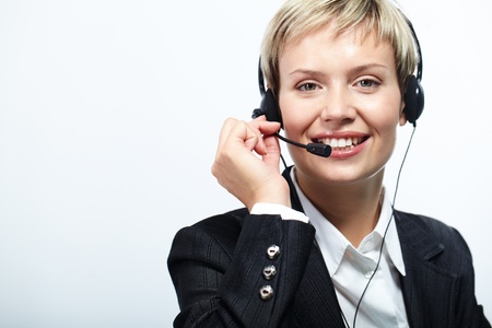 answering call: Portrait of friendly customer service representative isolated on white
