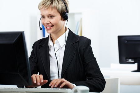 Portrait of young secretary working in office Stock Photo - 10699988