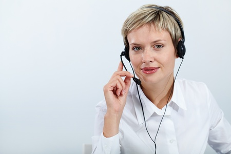 answering phone: Portrait of confident operator with headset isolated on white Stock Photo