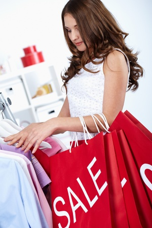 Young woman buying things at sales ped  Stock Photo - 10700039
