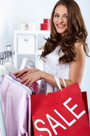 Portrait of happy woman with shopping bags at sales ped Stock Photo - 10699994