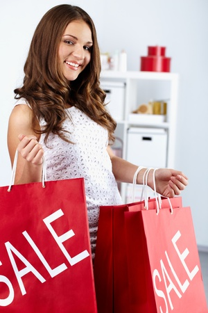 Portrait of happy woman with shopping bags Stock Photo - 10700041