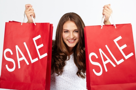 sale price: Portrait of happy woman with purchases from sale