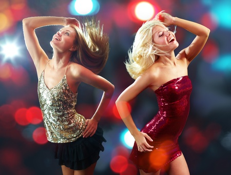 Two energetic girls dancing isolated  photo