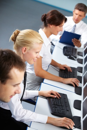 Row of business working with computers  photo