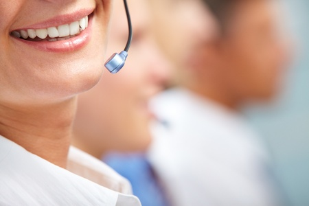 customer service representative: Close-up of female smiling lips with microphone