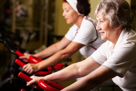 Two senior women training in gym Stock Photo - 10723606