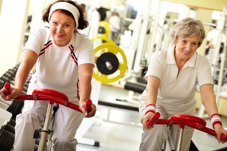 sporting activity: Two pretty senior women in health club