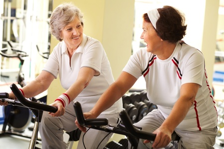 sporting activity: Two senior women training in health club