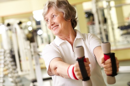 active seniors: Good-looking senior woman training in gym Stock Photo
