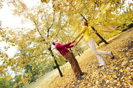 Happy couple enjoying autumn in park  photo