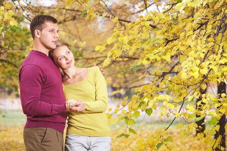 Young couple embracing in autumn park  photo