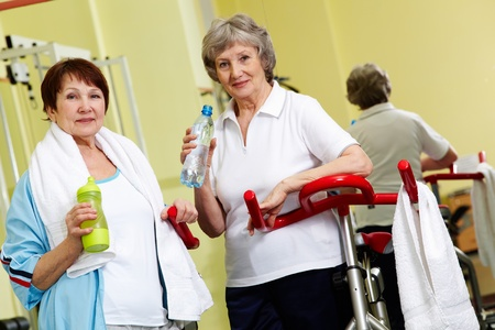 Portrait of two senior women in gym looking at camera  photo