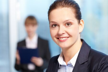 Close-up of young smiling businesswoman�s face photo