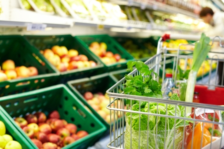 supermarket shopping: Image of fresh vegetables in cart in supermarket