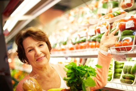 Image of senior woman in groceries department photo