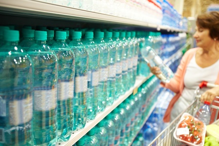 still water: Image of many plastic bottles with water in a shop