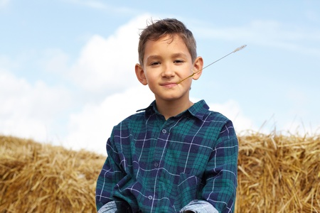 farm boys: Happy lad looking at camera in countryside Stock Photo