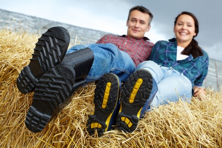 Happy couple spending time in countryside photo